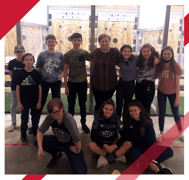 kids and adult at a fundraiser at an axe throwing range