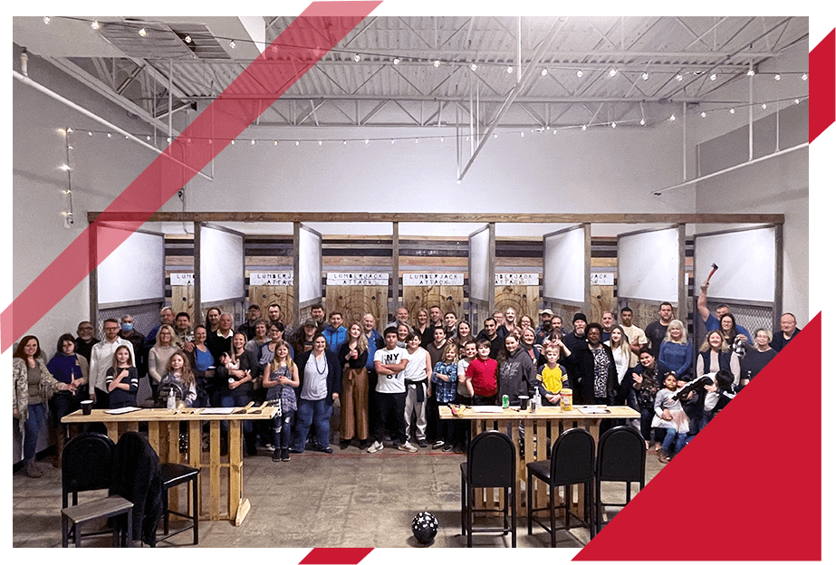 large group of people at axe throwing range